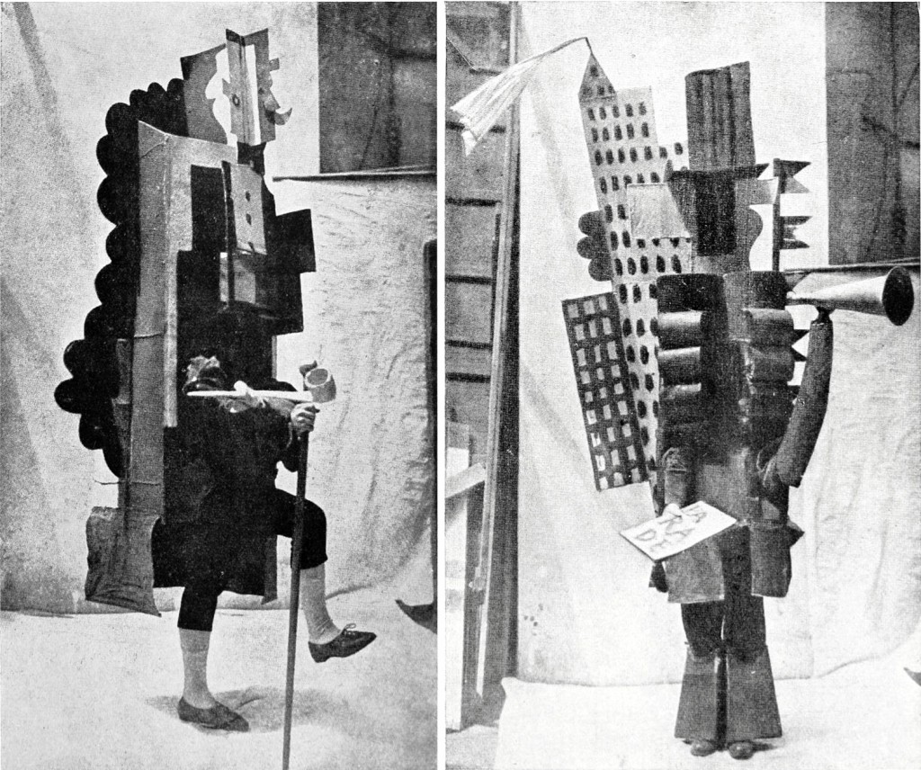 Two of the costumes designed by Picasso and made of wood, papier-mâché, metal and cloth.